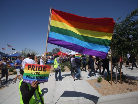Members of the community participate in the first annual Pride Festival march in the city of Coachella in support of the LGBTQ community of the Eastern Coachella Valley at Veteran's Park on May 6, 2017.