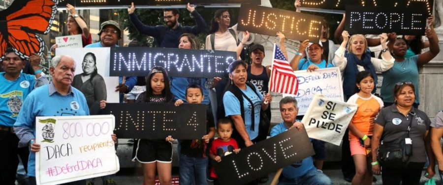 People march and chant slogans against President Donald Trump's proposed end of the DACA program that protects immigrant children from deportation at a protest in front of Trump International Hotel in New York City.