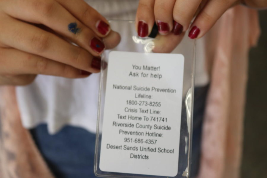 The back of student and staff IDs provides hotlines for support.
